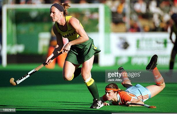 The Australian ''Hockeyroos'' player Louise Dobson leaves Minke Smabers of The Netherlands in her wake during the Womens Final against The...