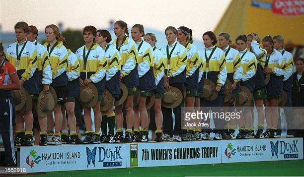 The Australian ''Hockeyroos'' players stand to listen to the Australian national anthem after their victory over The Netherlands in the Womens Final...