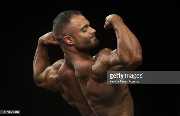 A contestant competes during the 2018 Toronto Pro Supershow IFBB Championships at Toronto Metro Convention Centre in Toronto Canada June 1 2018