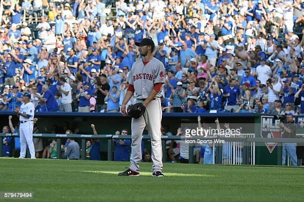 Boston Red Sox starting pitcher Rick Porcello watches asKansas City Royals' catcher Salvador Perez runs the bases after a solo home run during a...