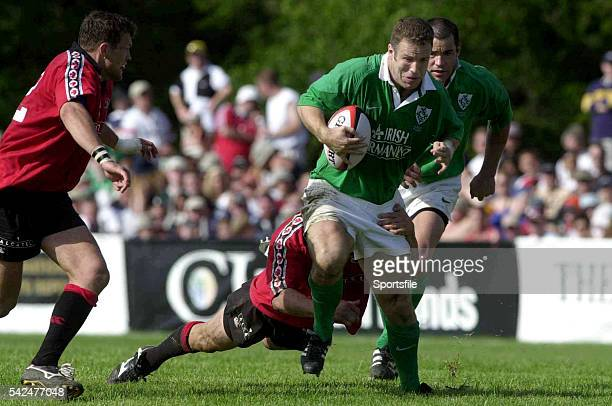 17 June 2000 Kevin Maggs Ireland is tackled by Scott Stewart and Mark Irvine Canada Rugby International Canada v Ireland Fletcher's Fields Ontario...