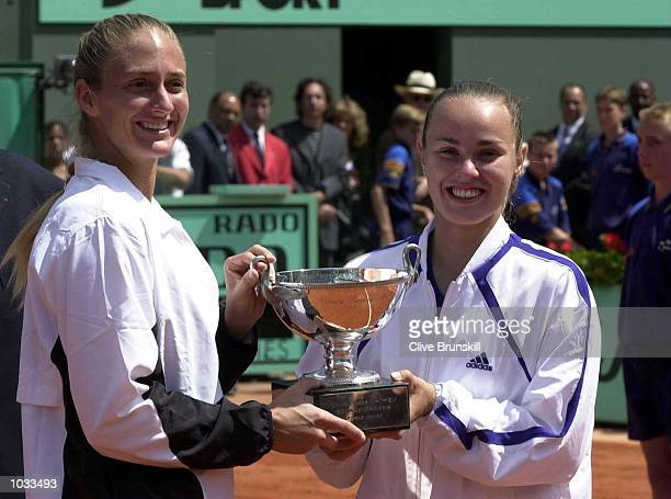 Mary Pierce of France and Martina Hingis of Switzerland with the trophy after their straight sets win in the Womens doubles final at the French Open,...