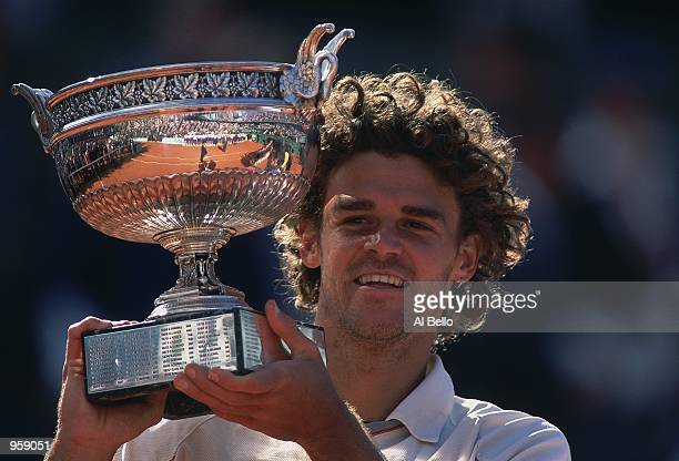 Gustavo Kuerten of Brazil holds the trophy after winning the French Open 2001 mens Final at Roland Garros, in Paris, France. \ Mandatory Credit: Al...