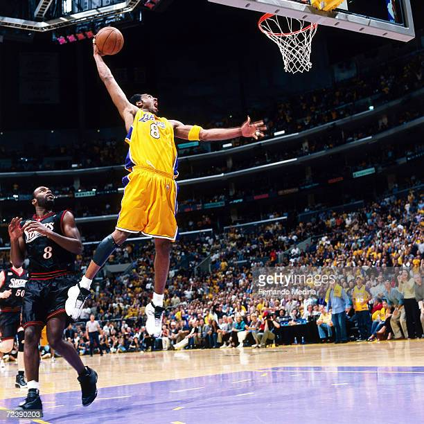 Kobe Bryant of the Los Angeles Lakers soars in for a slam dunk against the Philadelphia 76ers during game 2 of the NBA Finals at Staples Center in...
