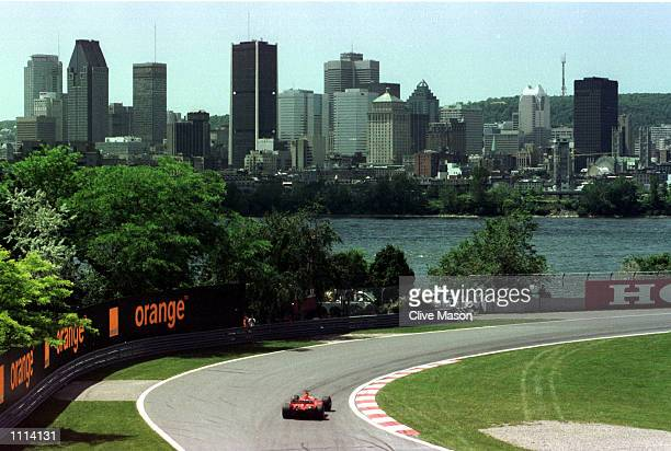 Rubens Barrichello of Brazil and Ferrari speeds around the picturesque Gilles Villeneuve circuit during first timed practice for the Formula One...