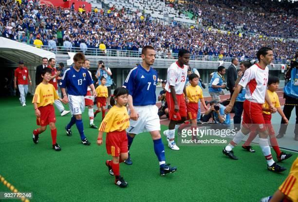 14 June 2002 2002 World Cup Football Tunisia v Japan Atsushi Yanagisawa of Japan Hidetoshi Nakata of Japan Jose Clayton of Tunisia and Mourad Melki...