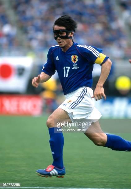14 June 2002 2002 World Cup Football Tunisia v Japan Japan captain Tsuneyasu Miyamoto wearing a mask