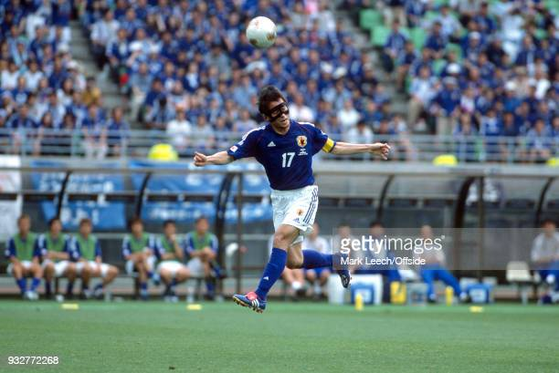 14 June 2002 2002 World Cup Football Tunisia v Japan Japan captain Tsuneyasu Miyamoto jumps up for a header