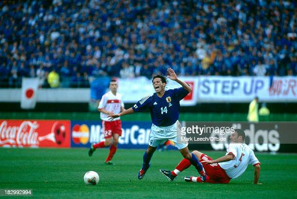 18 June 2002 FIFA World Cup Knockout Stage 1 Japan v Turkey Alessandro Santos of Japan is fouled by Alpay Ozalan of Turkey