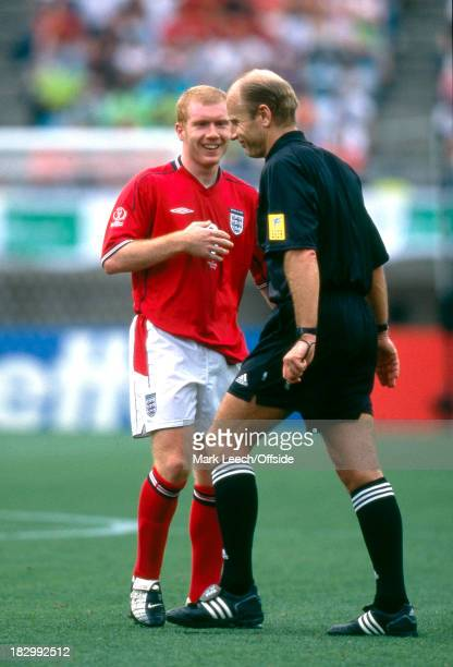 12 June 2002 FIFA World Cup Nigeria v England Paul Scholes of England and referee Brian Hall share a joke together