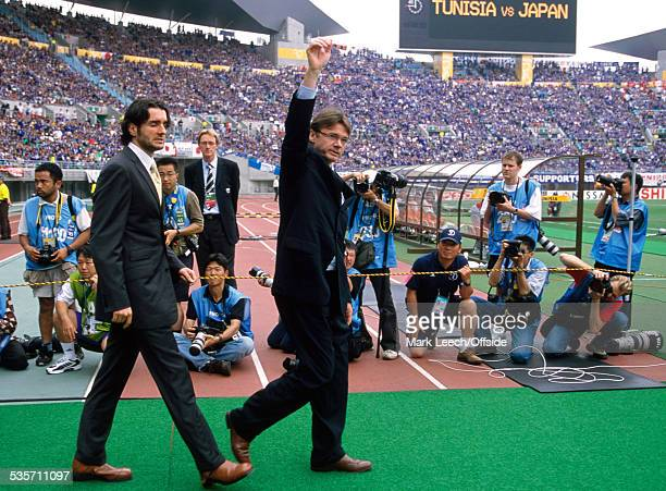 14 June 2002 FIFA World Cup Tunisia v Japan Japan coach Philippe Troussier waves to the crowd at the Nagai Stadium