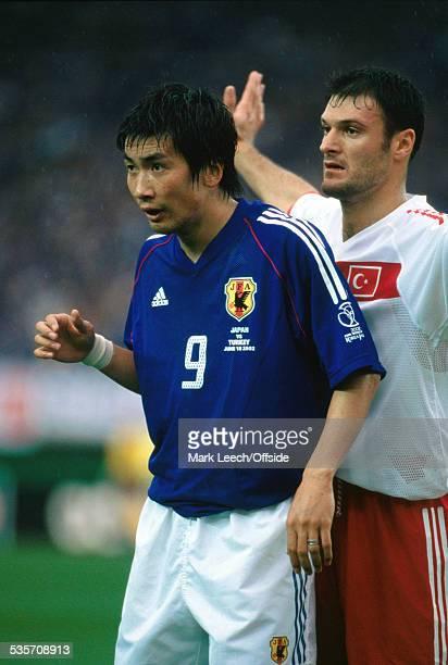 18 June 2002 FIFA World Cup Turkey v Japan Akinori Nishizawa of Japan is closely marked by Alpay Ozalan