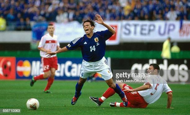 18 June 2002 FIFA World Cup Turkey v Japan Alessandro Santos of Japan is fouled by Alpay Ozalan of Turkey