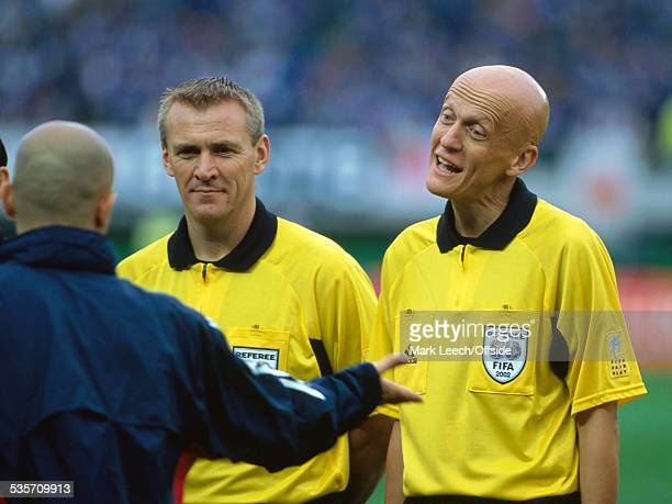 18 June 2002 FIFA World Cup Turkey v Japan Fourth official Graham Poll and referee Pierluigi Collina listen to protests from a Japanese coach after...