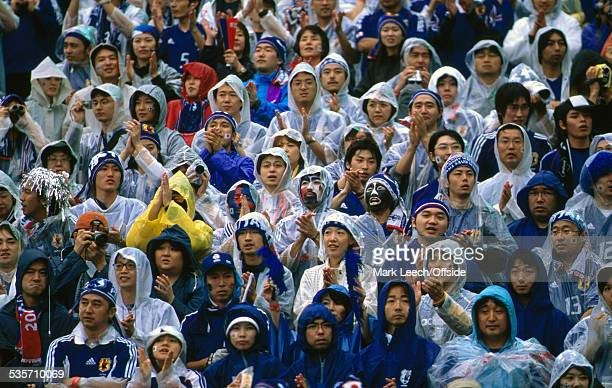 18 June 2002 FIFA World Cup Turkey v Japan Japanese supporters watch their team lose in the pouring rain
