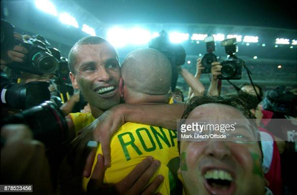 FIFA World Cup Final Brazil v Germany a fan invades the post match Brazil celebration between Rivaldo and Ronaldo
