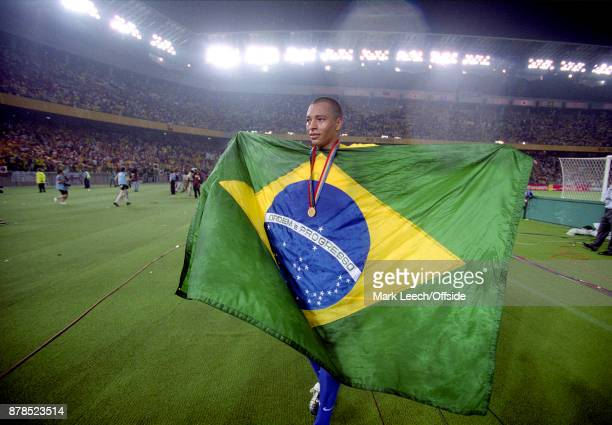 FIFA World Cup Final Brazil v Germany Gilberto Silva of Brazil celebrates on a lap of honour holding the Brazilian flag