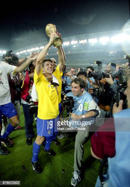 FIFA World Cup Final Brazil v Germany Juninho of Brazil is surrounded by photographers as he holds the trophy aloft