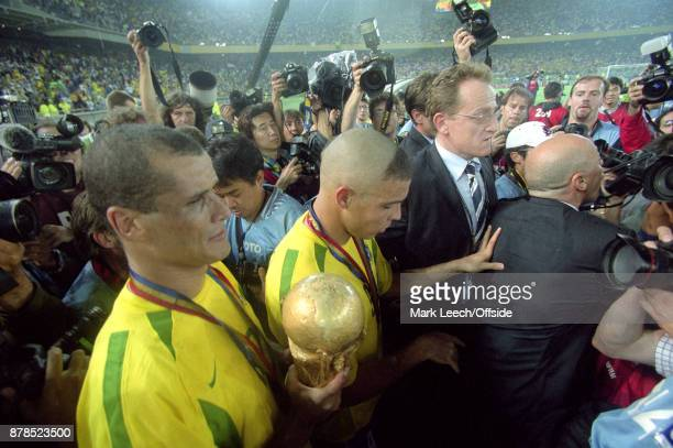 FIFA World Cup Final Brazil v Germany Rivaldo of Brazil is surrounded by photographers as he holds the trophy alongside Ronaldo