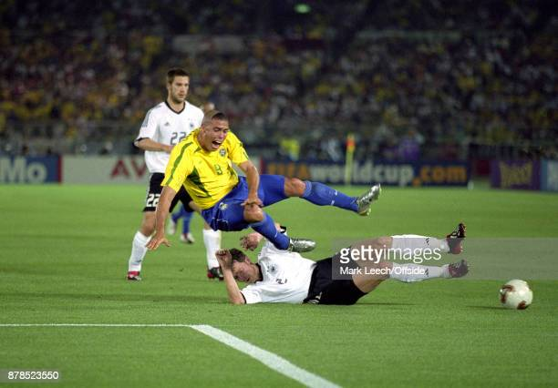 FIFA World Cup Final Brazil v Germany Ronaldo of Brazil is stopped by a slide tackle by Thomas Linke of Germany