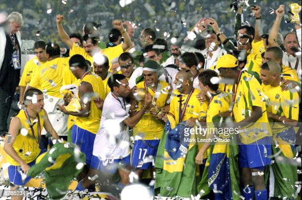 FIFA World Cup Final Brazil v Germany the happy Brazil squad hold the trophy as they are showered in glitter