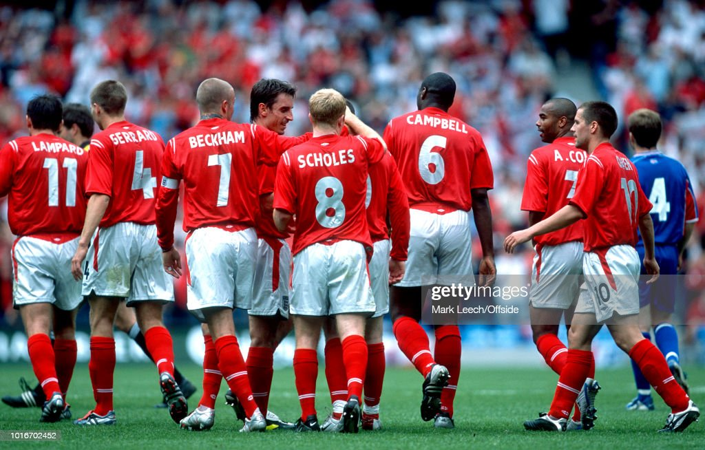 05 June 2004 - FA Summer Tournament - England v Iceland - England players (from l to r: Frank Lampard, Steven Gerrard, David Beckham, Gary Neville, Paul Scholes, Jamie Carragher, Ashley Cole and Micael Owen) celebrate the goal of Wayne Rooney -