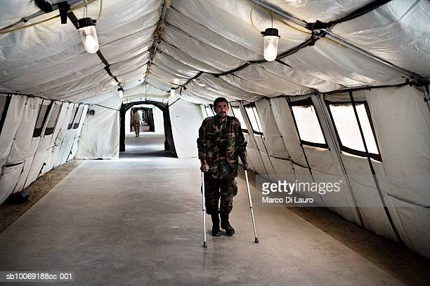 8 June 2007 Afghan National Army soldier walks on crutches in the corridor of the British Army Field Hospital as he recovers at Camp Bastion located...