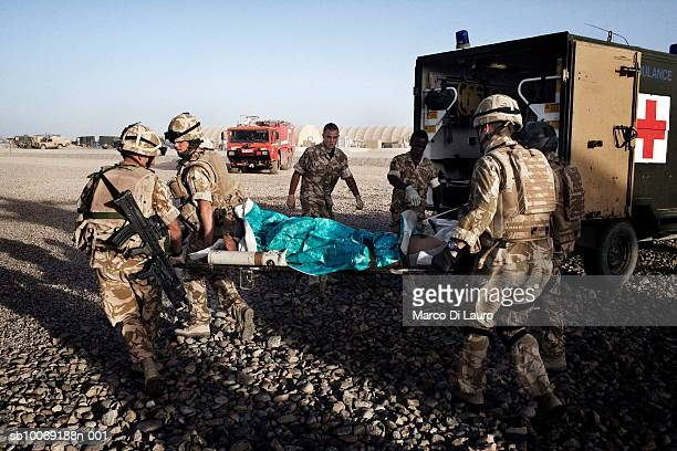 June 2007. British Army Medical Emergency Response team from the UK Med Group carry injured Afghan National Army Sgt. Quem Abdulh into an ambulance,...