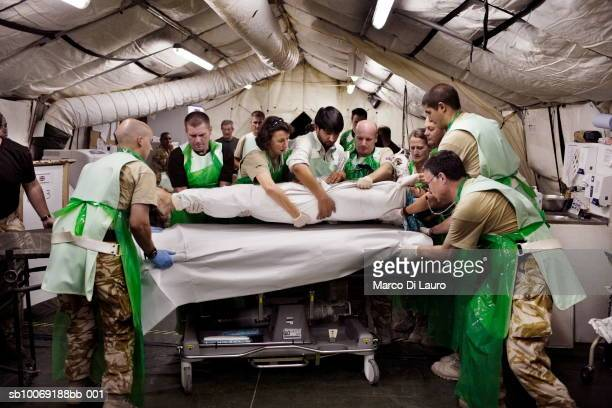 8 June 2007 British military medical personnel from the UK Med Group load Afghan National Army soldier Bashir into a bed in the RESUS at the British...