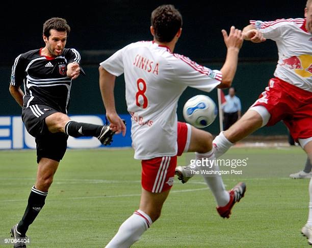 June 2007 CREDIT Katherine Frey / TWP Washington DC DC United vs NY Red Bulls Ben Olsen connects and scores between two NY Red Bulls defenders for...