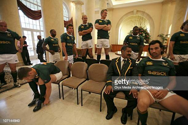 Springbok coach Peter de Villiers and acting captain Victor Matfield await a visit from Archbishop Emeritus and Nobel Laureate Desmond Tutu at the...