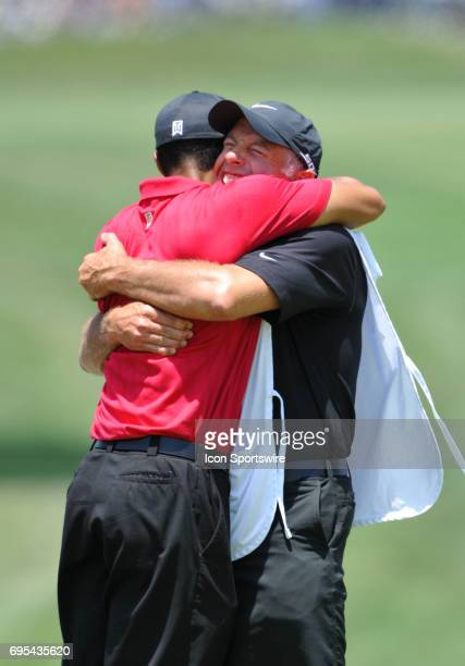 Tiger Woods hugs caddie Steve Williams after winning the 108th US Open Championship at Torrey Pines South Golf Course in San Diego CA