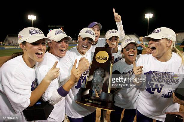 Washington pitcher Danielle Lawrie holds the National Championship trophy as the Huskies celebrate after winning the NCAA Women's College World...