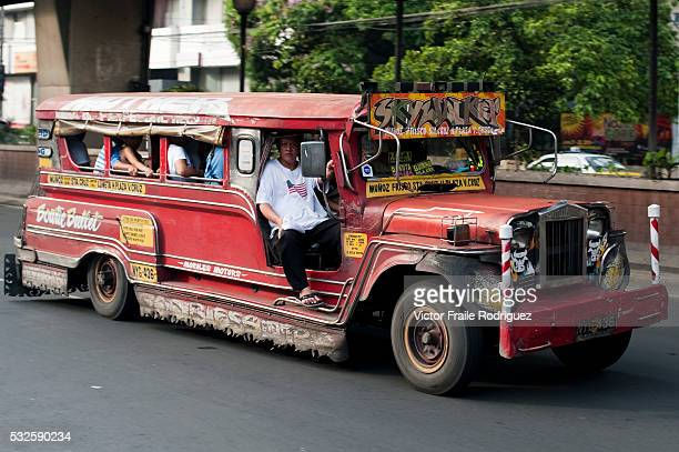05 June 2010 Manila Passengers in a colorful jeepney in Manila Philippines Jeepneys are the result of recycling US army jeeps left in the Philippines...