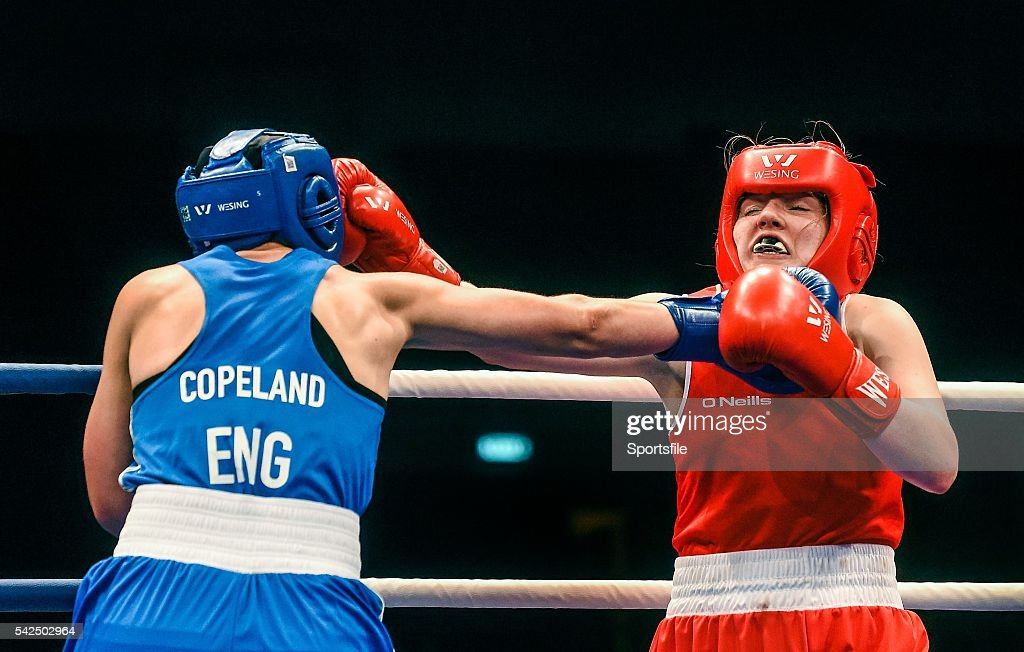 6 June 2014; Clare Grace, Ireland, exchanges punches with Stacey Copeland, England, left, during their 69kg Semi-Final bout. 2014 European Women's Boxing Championships Semi-Finals, Polivalenta Hall, Bucharest, Romania. Picture credit: Pat Murphy / SPORTSFILE