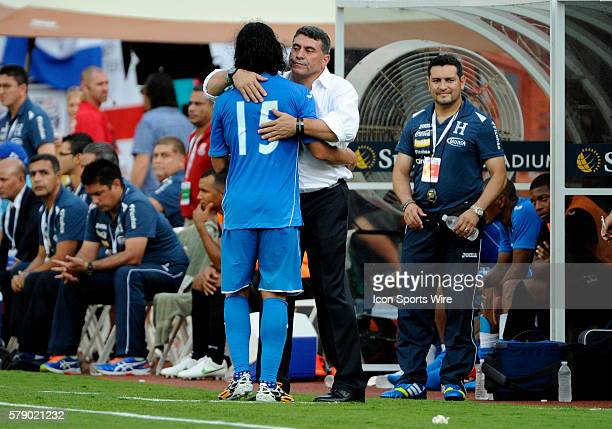 Honduras Midfielder Roger Espinoza leaves the match and hugs Honduras National Team Manager Luis Fernando Suarez during an international friendly...