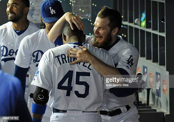Los Angeles Dodgers Pitcher JP Howell [4933] hugs and congratulates Los Angeles Dodgers Infield Carlos Triunfel [7671] after hitting his first major...