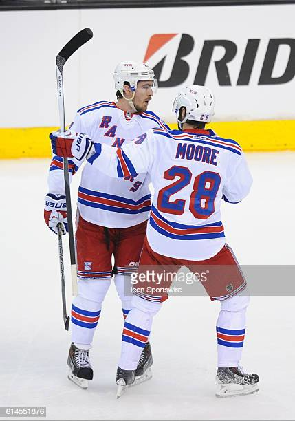 New York Rangers Defenseman Ryan McDonagh [6209] and New York Rangers Center Dominic Moore [2116] celebrate after scoring their first goal of the...