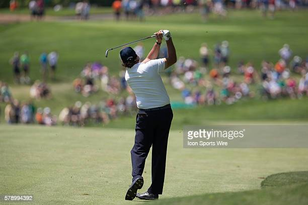 Phil Mickelson hits an approach shot during the final round of the Memorial Tournament held at the Muirfield Village Golf Club in Dublin OH
