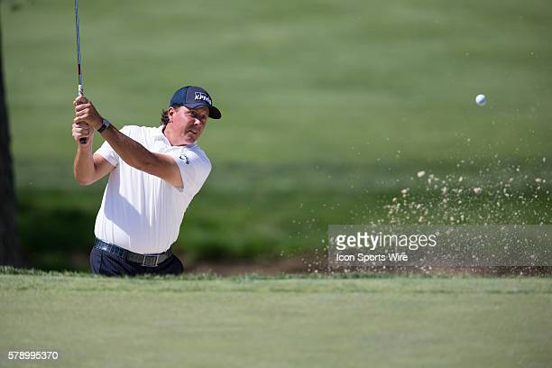 Phil Mickelson hits out of a sand trap during the final round of the Memorial Tournament held at the Muirfield Village Golf Club in Dublin OH