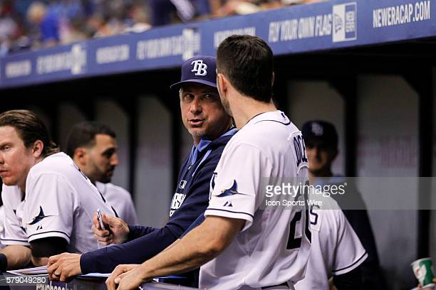 Tampa Bay Rays hitting coach Derek Shelton talks to Tampa Bay Rays left fielder Matt Joyce in the dugout during the MLB regular season game between...