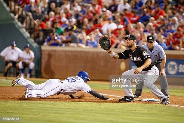 Texas Rangers Second base Rougned Odor [9855] dives back to first under a tag by Miami Marlins First base Garrett Jones [5205] during the MLB game...