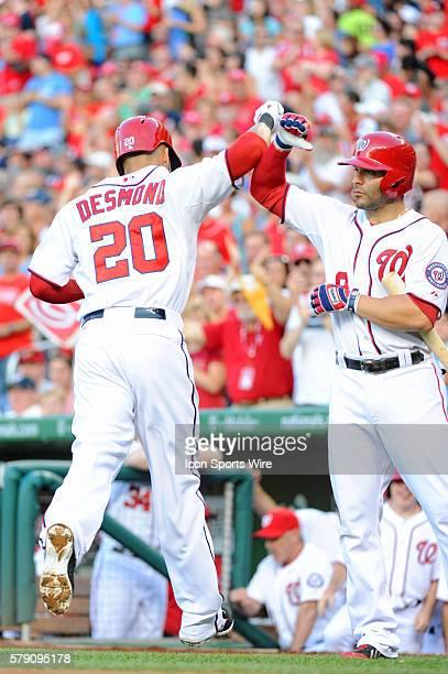 Washington Nationals shortstop Ian Desmond is congratulated by second baseman Danny Espinosa after his solo home run at Nationals Park in Washington...