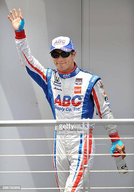 AJ Foyt Enterprises driver Takuma Sato waves to the fans during driver introductions before the MAVTV 500 held at the Auto Club Speedway in Fontana CA
