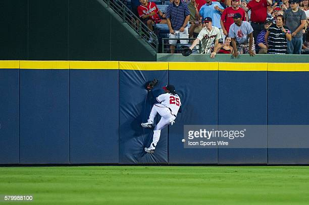 Atlanta Braves Center Fielder Cameron Maybin goes against the wall on a Boston Red Sox OutFielder Brock Holt triple during a regular season game...