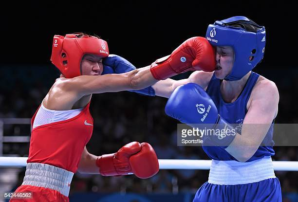 22 June 2015 Ceire Smith Ireland right exchanges punches with Saiana Sagataeva Russia during their Women's Boxing Fly 51kg Quarter Final bout 2015...