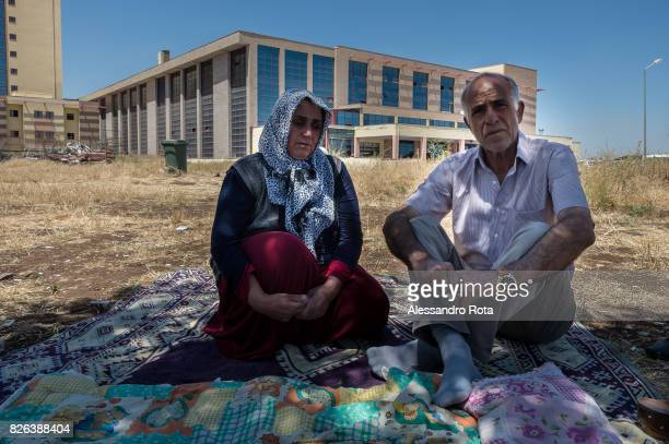 11 June 2015 Diyarbakir Turkey Hanim Kaya mother of Mutlu Kaya poses for a portrait with her husband Mehmet Kaya in their shelter outside the...