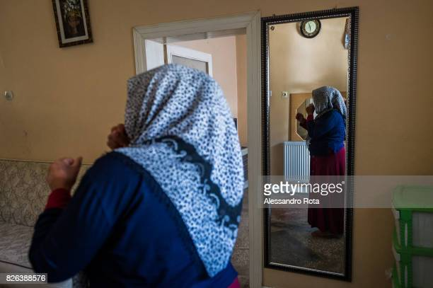 10 June 2015 Ergani Turkey Hanim Kaya mother of Mutlu Kaya enters accompanied by the older daughter Sevil Denizhan for the first time in the house...