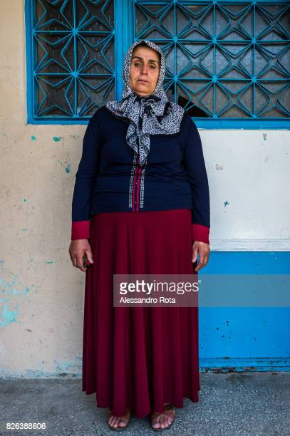 10 June 2015 Ergani Turkey Hanim Kaya mother of Mutlu Kaya poses for a portrait outside the house where Mutlu was shot in the head on the night of...