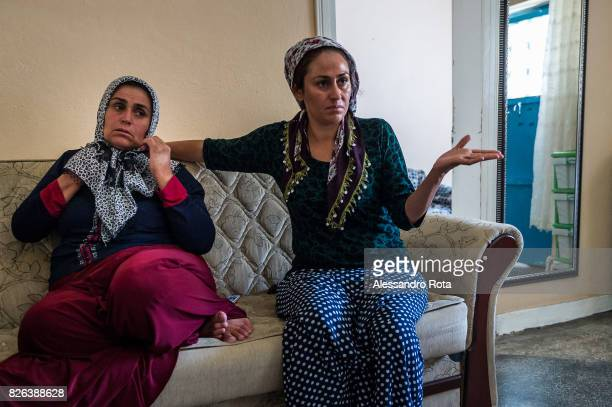 10 June 2015 Ergani Turkey Hanim Kaya mother of Mutlu Kaya remembers moments of joy with her older daughter Sevil Denizhan in the house where Mutlu...